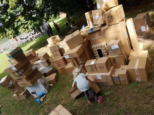 Children building with cardboard boxes at Playday.